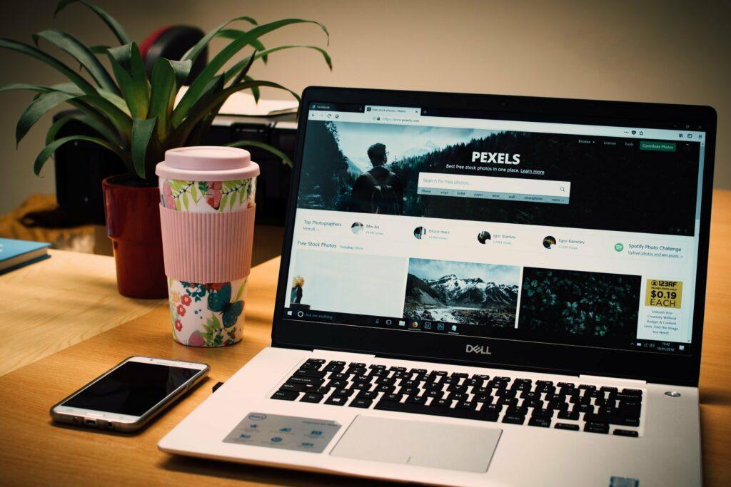 Photo of Pexels homepage on laptop